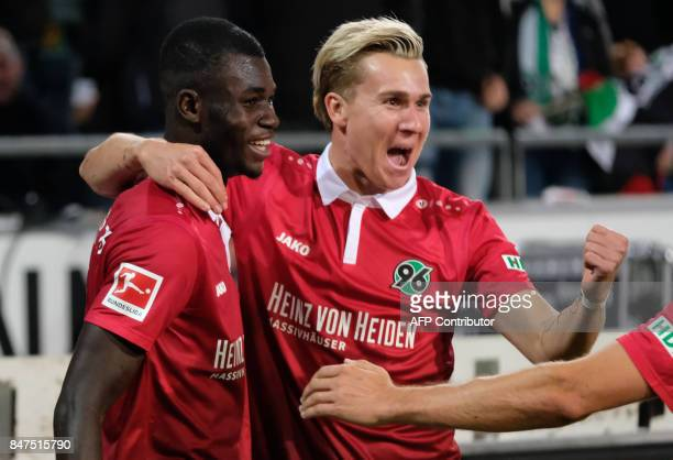 Hanover's Togolese forward Ihlas Bebou celebrate scoring the 20 goal with Hanover's German forward Felix Klaus during the German first division...