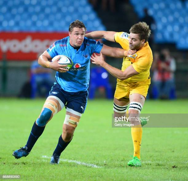 Hanro Liebenberg of the Bulls tackled by Tomas Lezana of the Jaguares during the Super Rugby match between Vodacom Bulls and Jaguares at Loftus...