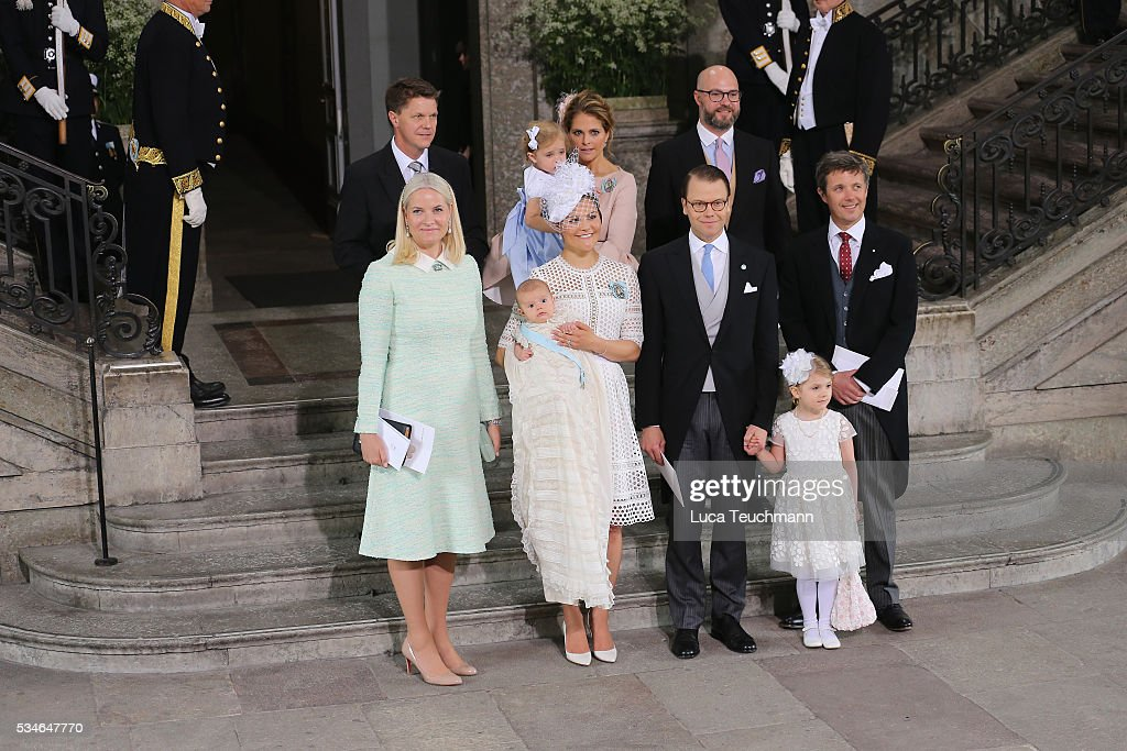 Hans Astrom, Princess Madeleine of Sweden; Princess Leonore of Sweden, Oscar Magnuson, (Front L-R) Crown Princess Mette-Marit of Norway, Crown Princess Victoria of Sweden, Prince Oscar of Sweden, Prince Daniel of Sweden,Princess Estelle of Sweden and Crown Prince Frederik of Denmark are seen at The Royal Palace for the Christening of Prince Oscar of Sweden on May 27, 2016 in Stockholm, Sweden.