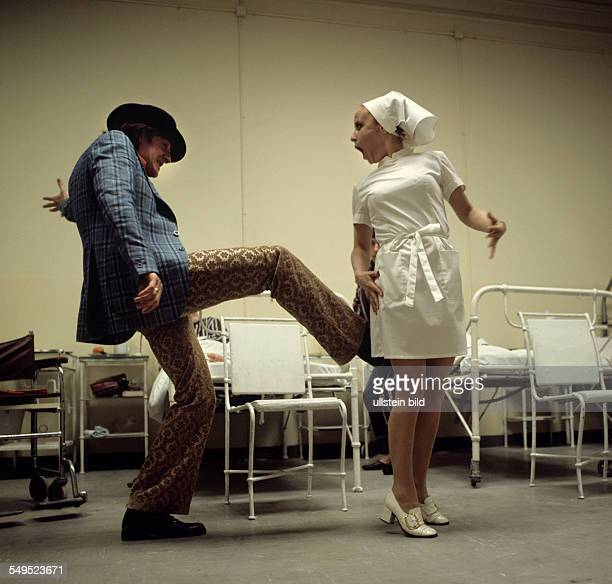 Hans Brenner kicking up the backside of Ruth Brand in Wolfgang Bauer's play 'Change'