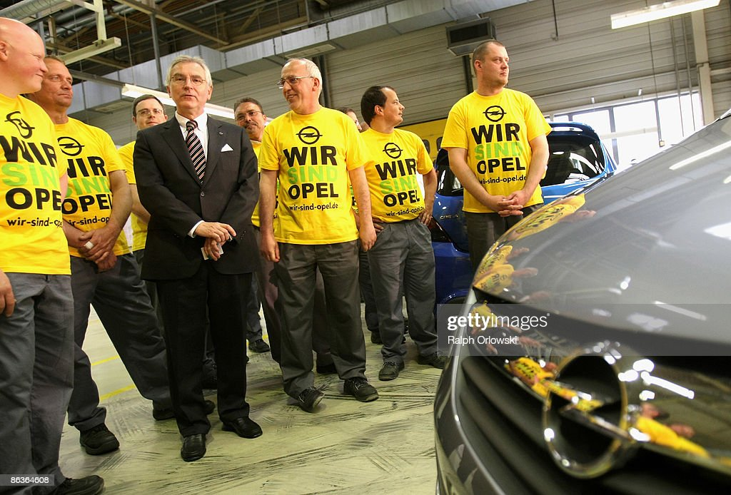 Hans Demant (3rd L), chief of German carmaker Adam Opel GmbH stands amid workers at a plant on May 4, 2009 in Eisenach, Germany. Representatives of the German government, officials of car manufacturer Opel and managers of Italian carmaker Fiat will meet today in Berlin to discuss a merger between Fiat, Opel and U.S. carmaker Chrysler.