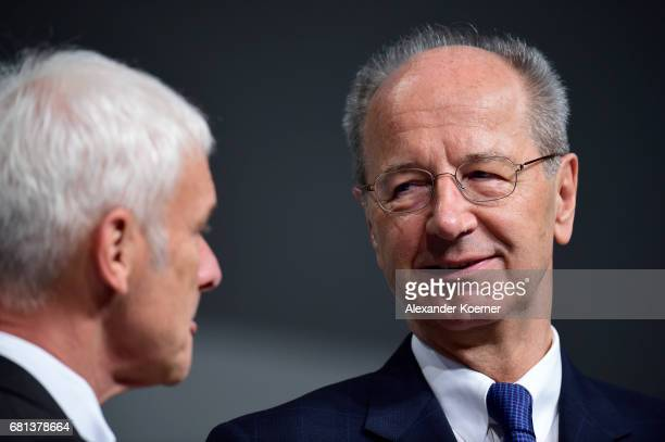 Hans Dieter Poetsch and Matthias Mueller CEO of German carmaker Volkswagen AG arrive for the company's annual general shareholders meeting on May 10...