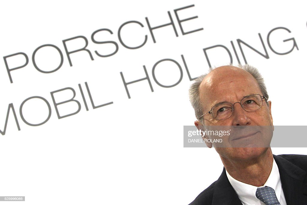 Hans Dieter Poetsch, CEO of German car maker Porsche SE, addresses the media during the company's annual press conference to present the business report in Stuttgart, Germany, on April 29, 2016. / AFP / DANIEL