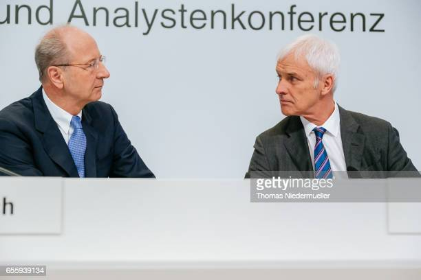 Hans Dieter Poetsch CEO of German company Porsche SE talks to Matthias Mueller member of the board strategy and corporate development and CEO...