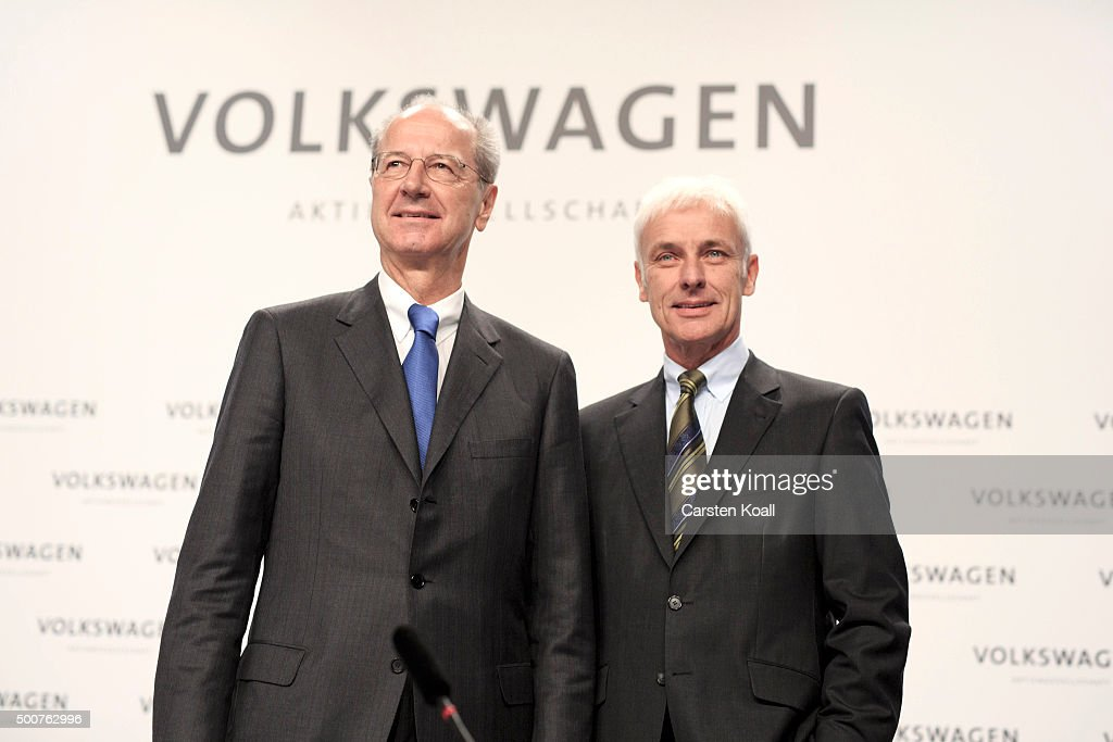 Hans Dieter Poetsch (L), Chairman of the Supervisory Board of Volkswagen AG, and Volkswagen Group Chairman Matthias Mueller (R), arrive to the press conference to announce the latest update in the company's handling of the engine emissions scandal on December 10, 2015 in Wolfsburg, Germany. Volkswagen is continuing to grapple with the consequences after it admitted installing software that cheats during emissions tests into 11 million of its diesel cars sold worldwide.