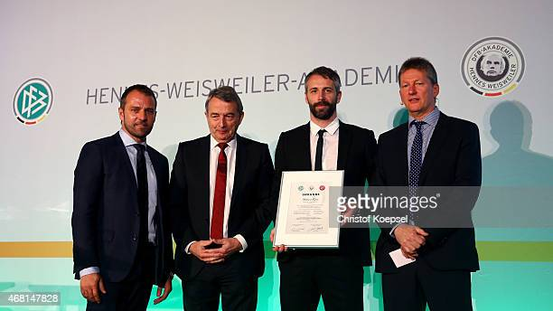 Hans Flick sporting director of the DFB Wolfgang Niersbach president of the DFB and Frank Wormuth leader of the football coaching course honour new...