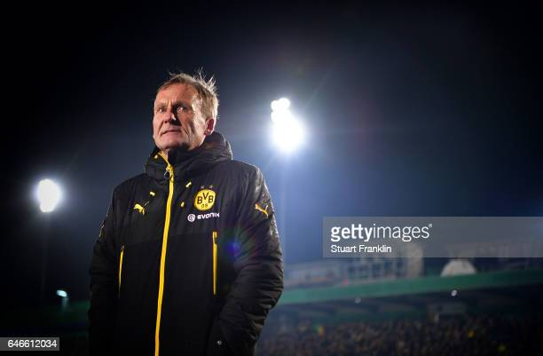 Hans Joachim Watzke CEO of Dortmund looks oh as the game is called off due to an unplayable pitch prior to the DFB Cup quarter final between...