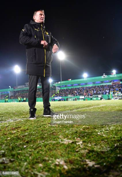 Hans Joachim Watzke CEO of Dortmund walks on the pitch as the game is called off due to an unplayable pitch prior to the DFB Cup quarter final...