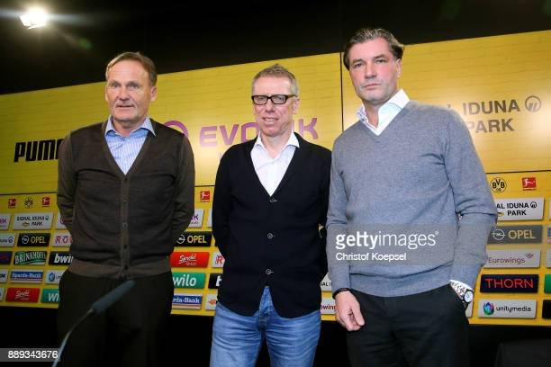 Hans Joachim Watzke chairman of the board and manager Michael Zorc present Peter Stoeger as the new head coach during the press conference at Signal...