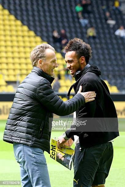 Hans Joachim Watzke chairman of the board welcomes PierreEmerick Aubameyang of Dortmund prior to the Bundesliga match between Borussia Dortmund and...
