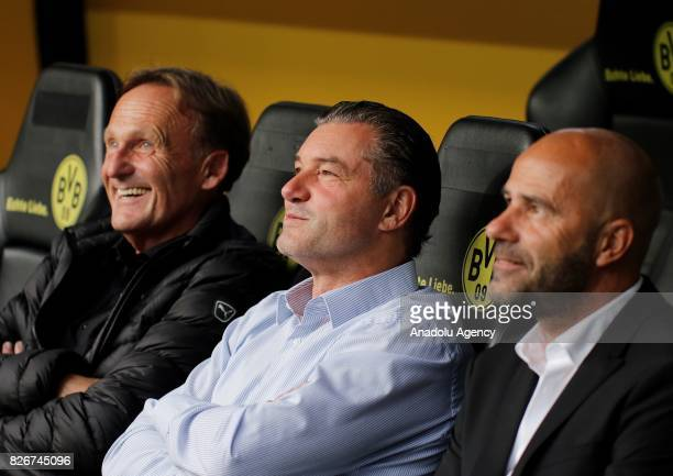 Hans Joachim Watzke Sport director Michael Zorc and Headcoach Peter Bosz of Borussia Dortmund are seen ahead of the DFL Super Cup 2017 final match...