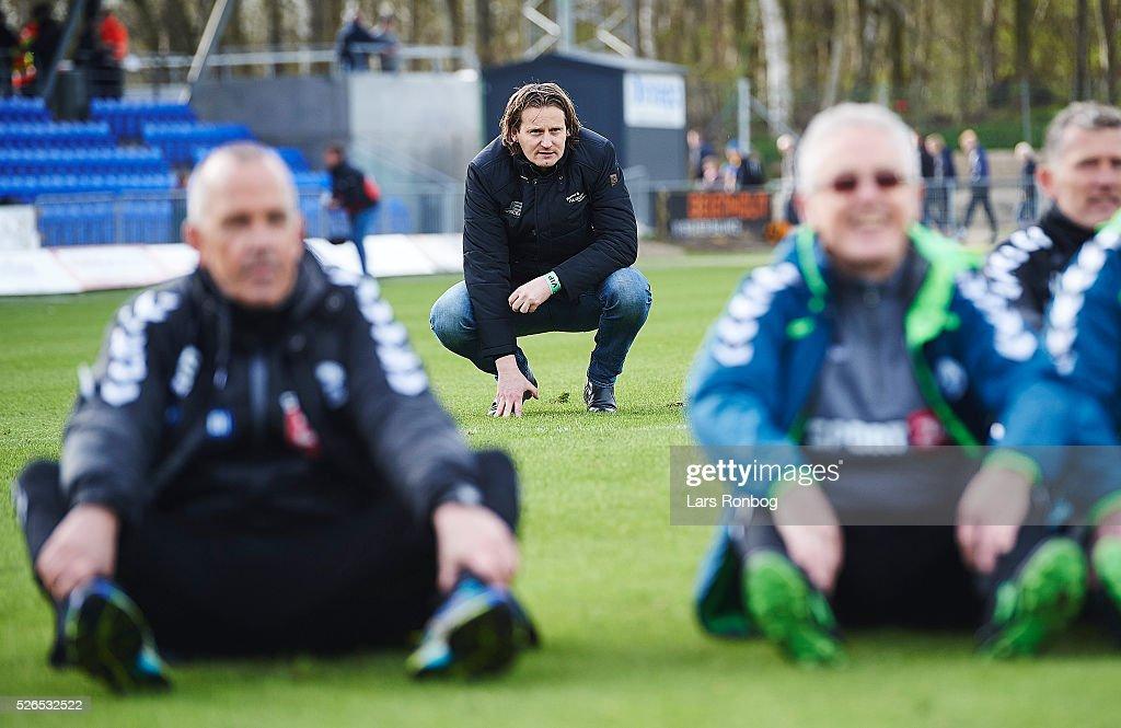 Hans Jorgen Haysen, sports director of Sonderjyske looks on after the Danish Alka Superliga match between Hobro IK and Sonderjyske at DS Arena on April 30, 2016 in Hobro, Denmark.