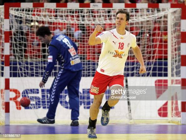 Hans Lindberg of Denmark celebrates a goal against Darko Stanic of Serbia during the Men's European Handball Championship final match between Serbia...
