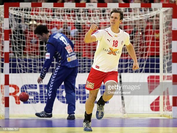 Hans Lindberg of Denmark celebrates a goal against Darko Stanic of Serbia during the Men's European Handball Championship final match between Serbia...