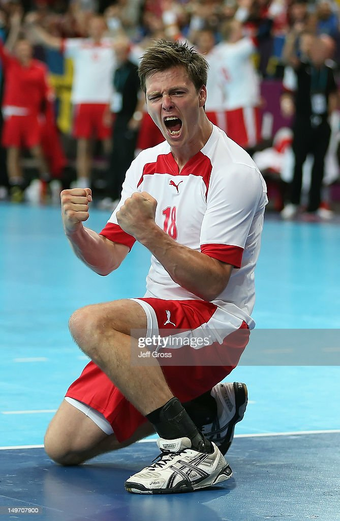 <a gi-track='captionPersonalityLinkClicked' href=/galleries/search?phrase=Hans+Lindberg&family=editorial&specificpeople=863614 ng-click='$event.stopPropagation()'>Hans Lindberg</a> #18 of Denmark celebrates after scoring in the closing minutes of the Men's Preliminaries Group B match between Serbia and Denmark on Day 6 of the London 2012 Olympic Games at The Copper Box on August 2, 2012 in London, England.