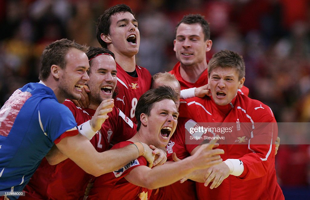 <a gi-track='captionPersonalityLinkClicked' href=/galleries/search?phrase=Hans+Lindberg&family=editorial&specificpeople=863614 ng-click='$event.stopPropagation()'>Hans Lindberg</a> (C) of Denmark celebrates the winning score against Macedonia with the team-mates during the Men's European Handball Championship 2012 second round group one match between Denmark and Macedonia at Belgrade Arena Hall on January 21, 2011 in Belgrade, Serbia.