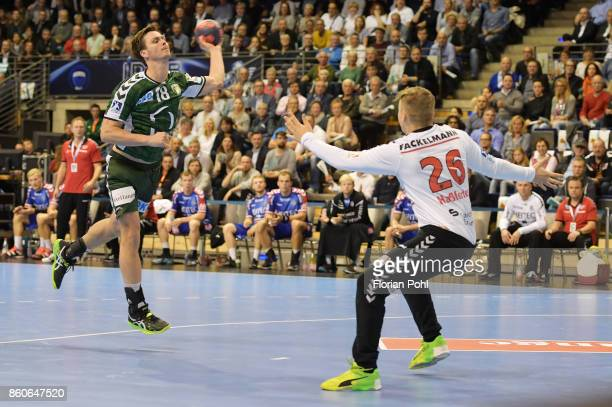 Hans Lindberg of Fuechse Berlin and Michael Hassferter of HC Erlangen during the game between Fuechse Berlin and the HC Erlangen on S2eptember 12...