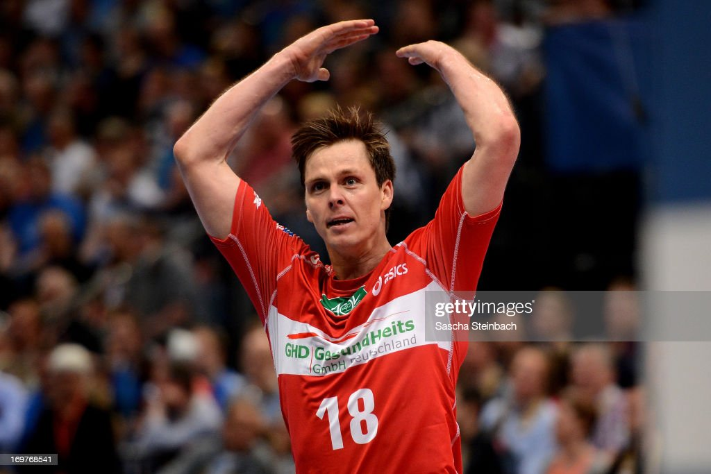 <a gi-track='captionPersonalityLinkClicked' href=/galleries/search?phrase=Hans+Lindberg&family=editorial&specificpeople=863614 ng-click='$event.stopPropagation()'>Hans Lindberg</a> of Hamburg celebrate after the EHF Final Four match between THW Kiel and HSV Hamburg at Lanxess Arena on June 1, 2013 in Cologne, Germany.