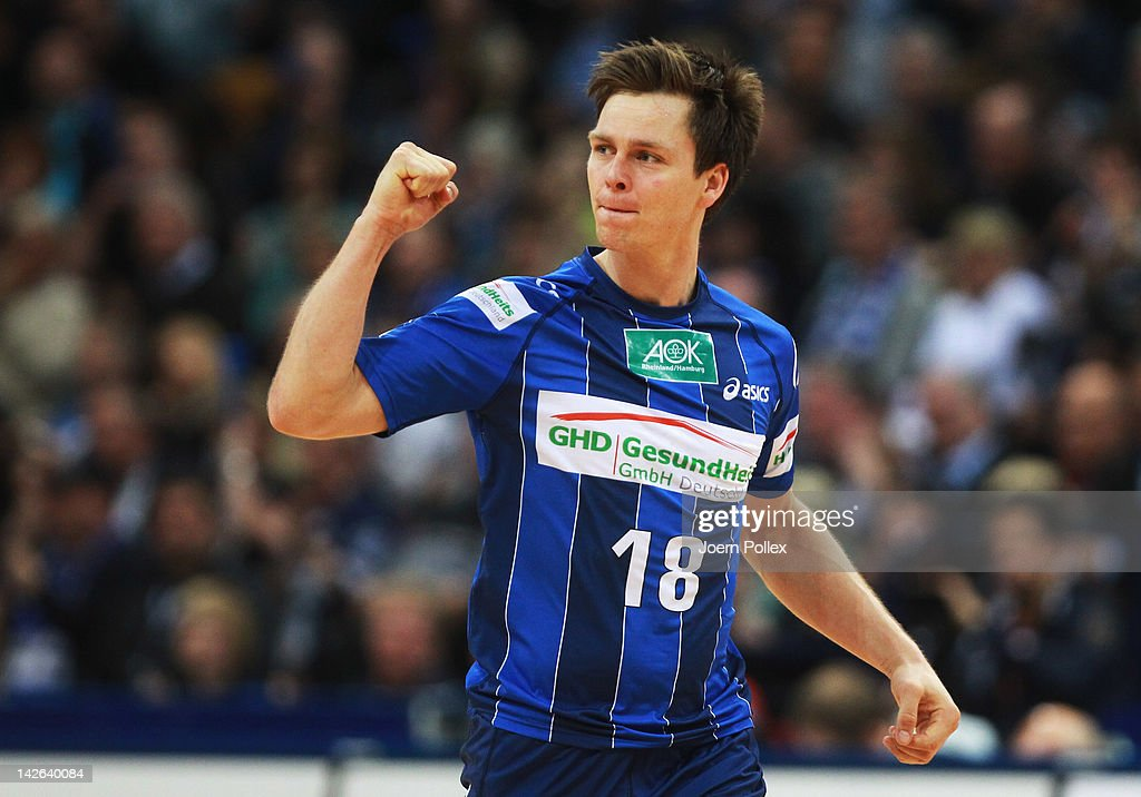 <a gi-track='captionPersonalityLinkClicked' href=/galleries/search?phrase=Hans+Lindberg&family=editorial&specificpeople=863614 ng-click='$event.stopPropagation()'>Hans Lindberg</a> of Hamburg celebrates during the Toyota Bundesliga handball game between HSV Hamburg and Rhein-Neckar Loewen at the O2 World on April 10, 2012 in Hamburg, Germany.