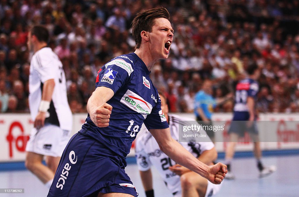 <a gi-track='captionPersonalityLinkClicked' href=/galleries/search?phrase=Hans+Lindberg&family=editorial&specificpeople=863614 ng-click='$event.stopPropagation()'>Hans Lindberg</a> of Hamburg celebrates during the Toyota Handball Bundesliga match between THW Kiel and HSV Hamburg at the Sparkassen Arena on April 20, 2011 in Kiel, Germany.