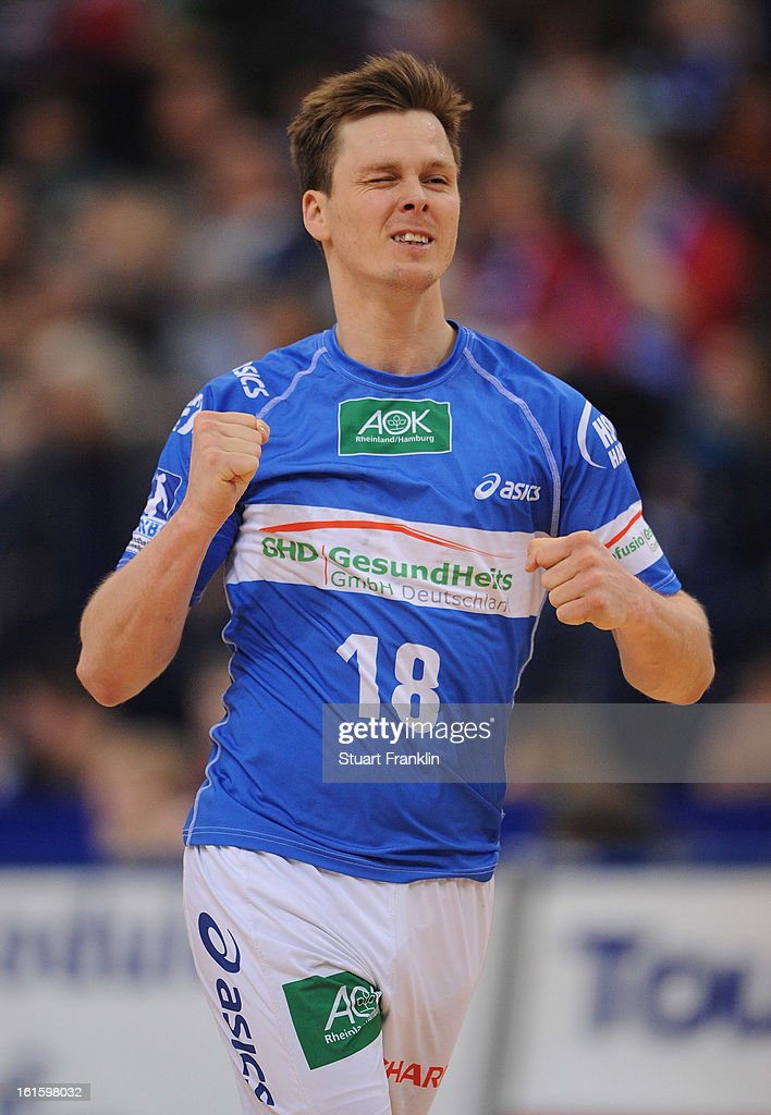 <a gi-track='captionPersonalityLinkClicked' href=/galleries/search?phrase=Hans+Lindberg&family=editorial&specificpeople=863614 ng-click='$event.stopPropagation()'>Hans Lindberg</a> of Hamburg celebrates scoring a goal during the Bundesliga match between Hamburger SV and SC Magdeburg at the O2 world on February 12, 2013 in Hamburg, Germany.
