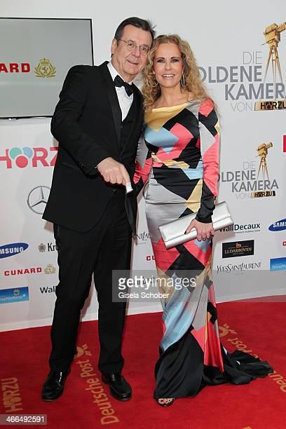Hans Mahr and wife Katja Burkard attend the Goldene Kamera 2014 at Tempelhof Airport Hangar 7 on February 1 2014 in Berlin Germany