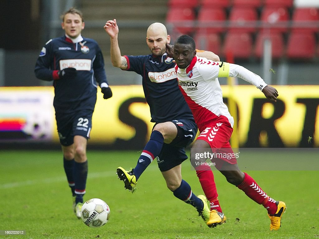 Hans Mulder of Willem II, Nana Asare of FC Utrecht during the Dutch Eredivise match between FC Utrecht and Willem II at the Galgenwaard Stadium on January 27, 2013 in Utrecht, The Netherlands.