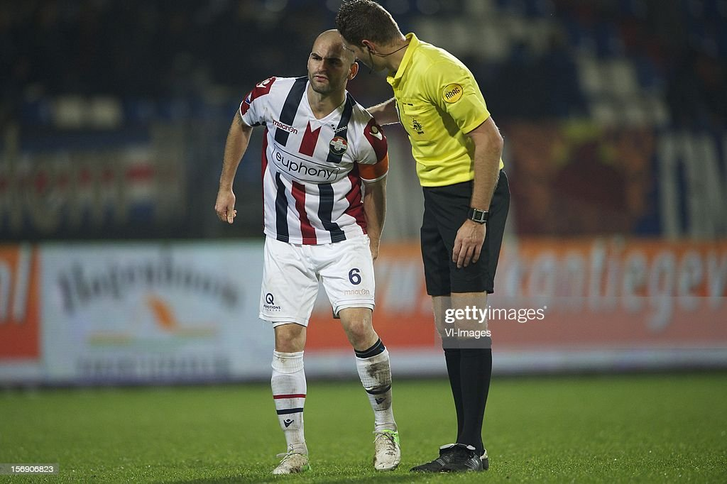Hans Mulder of Willem II, referee Pol van Boekel during the Dutch Eredivisie match between Willem II and Heracles Almelo at the Koning Willem II Stadium on November 24, 2012 in Tilburg, The Netherlands.