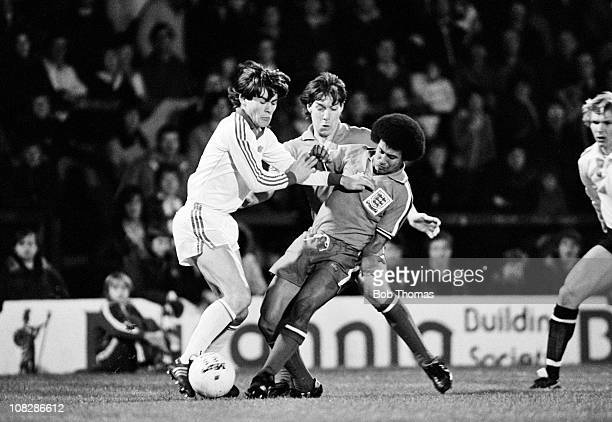 Hans Peter Zwicker of Switzerland is tackled by England defenders Ray Ranson and Remi Moses during the UEFA Under21 Championship Qualifying match at...
