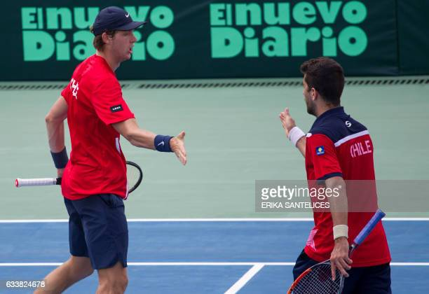 Hans Podlipnik and Nicolas Jarry of Chile celebrate during the Davis Cup first round double tennis match against the Dominican Republic at Parque del...