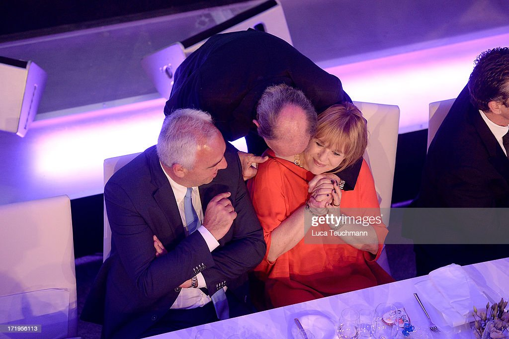 Hans Reiner Schroeder (L) and Patricia Riekel attend the 'BMW Golf Cup International 2013 - Charity Gala' at BMW Berlin on June 29, 2013 in Berlin, Germany.