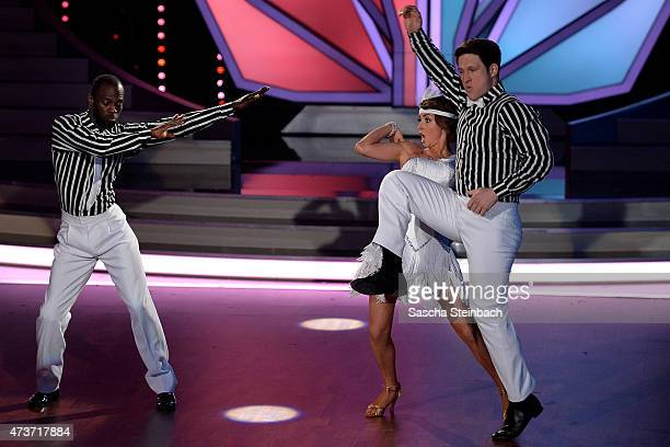 Hans Sarpei and Kathrin Menzinger battle Matthias Steiner and Ekaterina Leonova during the 9th show of the television competition 'Let's Dance' on...