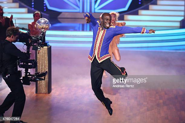 Hans Sarpei and Kathrin Menzinger celebrate after winning the award during the final show of the television competition 'Let's Dance' on June 5 2015...