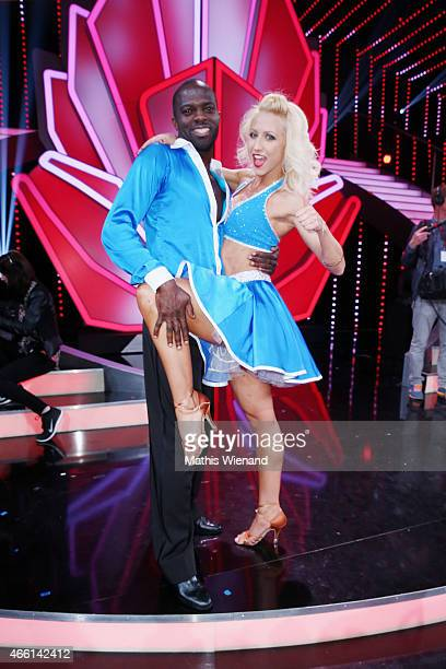 Hans Sarpei and Kathrin Menzinger perform on stage during the 1st show of the television competition 'Let's Dance' on March 13 2015 in Cologne Germany