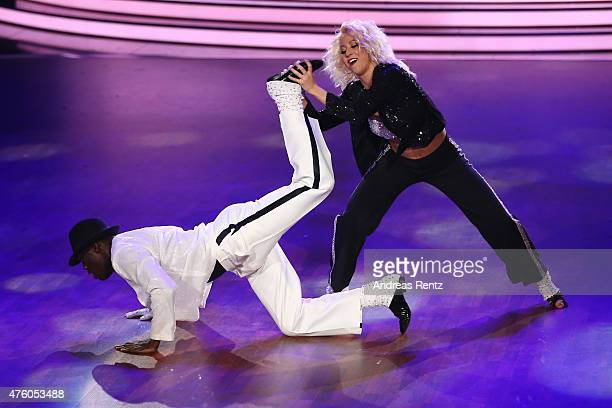 Hans Sarpei and Kathrin Menzinger perform on stage during the final show of the television competition 'Let's Dance' on June 5 2015 in Cologne Germany