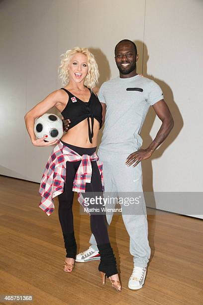 Hans Sarpei and Kathrin Menzinger pose at a photo call for the television competition 'Let's Dance' on March 10 2015 in Cologne Germany On March 13th...