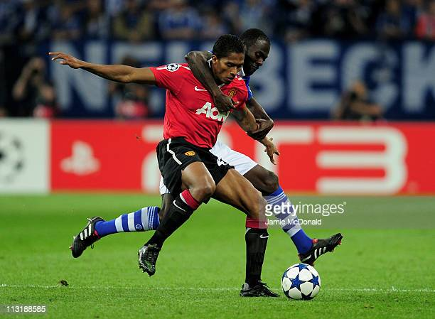 Hans Sarpei of Schalke tangles with Antonio Valencia of Manchester United during the UEFA Champions League Semi Final first leg match between FC...
