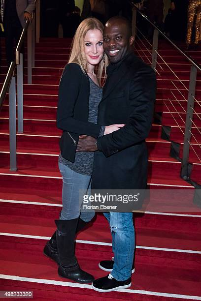 Hans Sarpei with wife Pia Sarpei attend the 'Bodyguard Das Musical' gala premiere at Musical Dome Koeln on November 21 2015 in Cologne Germany