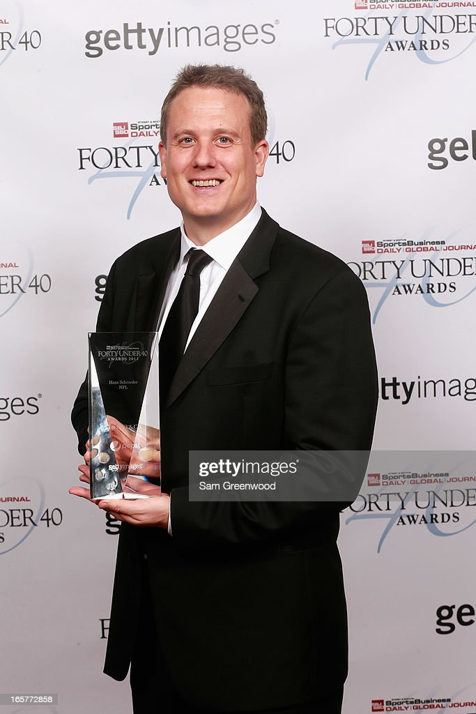 Hans Schroeder of NFL poses with award at the 2013 Forty Under 40 Awards on April 4, 2013 in Naples, Florida.