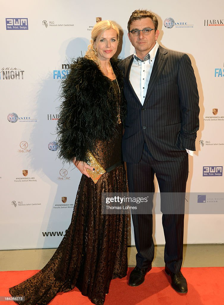 Hans Siegel and Susanne Sigl pose during the Minx fashion night at Residenz on October 12, 2013 in Wuerzburg, Germany. The benefit of the charity gala is for the aid organisation 'Sauti Kuu' of Auma Obama. Behind the fashion label Minx stands Eva Lutz.