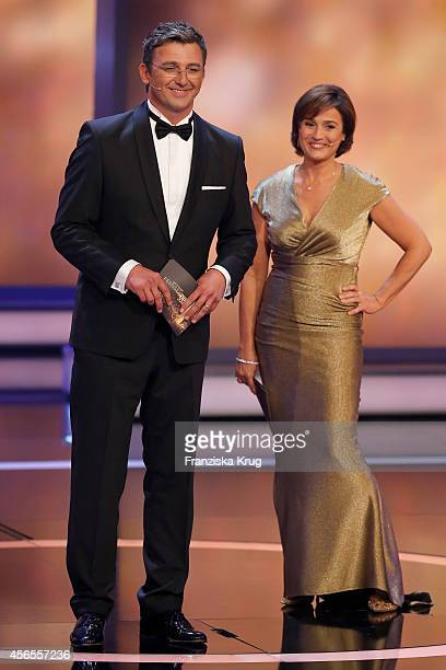 Hans Sigl and Sandra Maischberger attend the Deutscher Fernsehpreis 2014 show on October 02 2014 in Cologne Germany