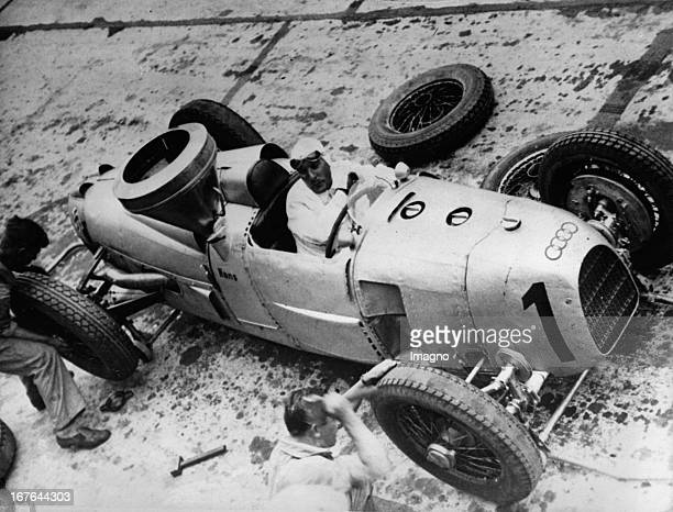 Hans Stuck German motor racing driver at the Grand Prix of Germany in his AutoUnionCar Nuerburgring 1934 Photograph Der deutsche Automobilrennfahrer...