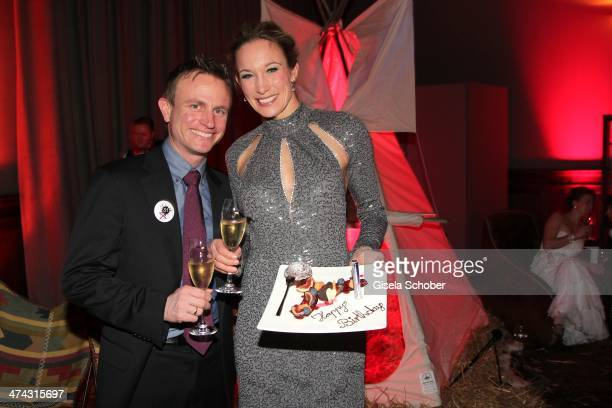Hans Theiss and Christine Theiss get a birthday cake at the Dresswestern party at Rilano No 6 on February 22 2014 in Munich Germany