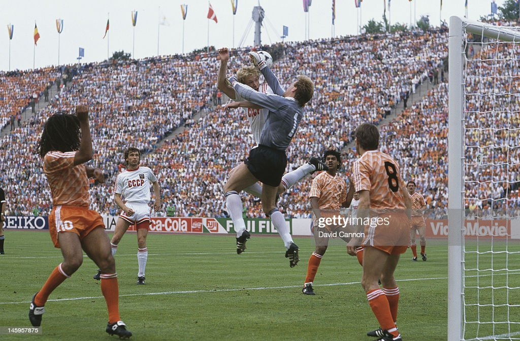 Hans van Breukelen of Netherlands makes a save as Oleksiy Mykhailychenko of USSR makes a challenge during the UEFA European Championships 1988 Final...