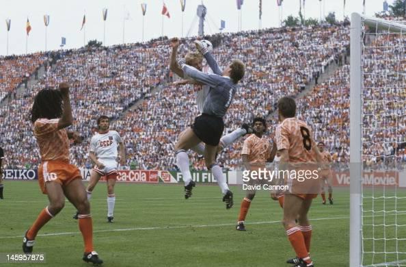 Hans van Breukelen of Netherlands makes a save as Oleksiy Mykhailychenko of USSR makes a challenge during the UEFA European Championships 1988 Final...