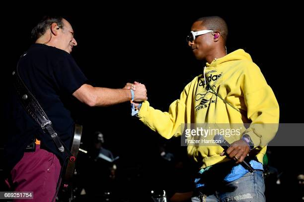 Hans Zimmer and Pharrell Williams embrace onstage at the Outdoor Theatre during day 3 of the Coachella Valley Music And Arts Festival at the Empire...