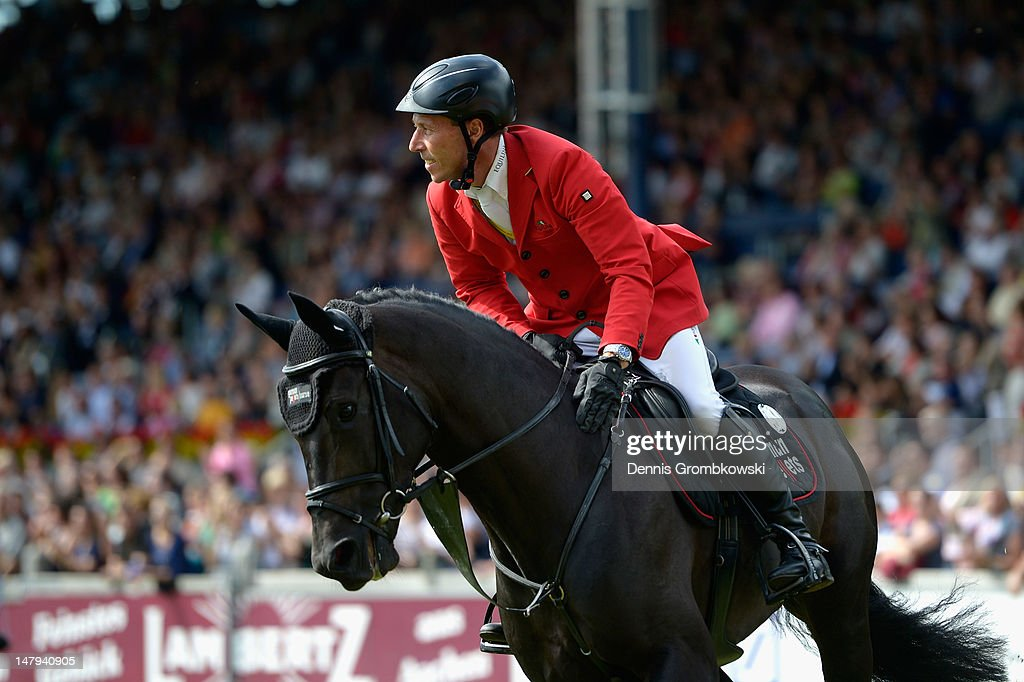 Hans-Dieter Dreher of Germany and his horse Embassy II compete in the RWE Prize of North-Rhine-Westphalia jumping competition during day four of the 2012 CHIO Aachen tournament on July 6, 2012 in Aachen, Germany.