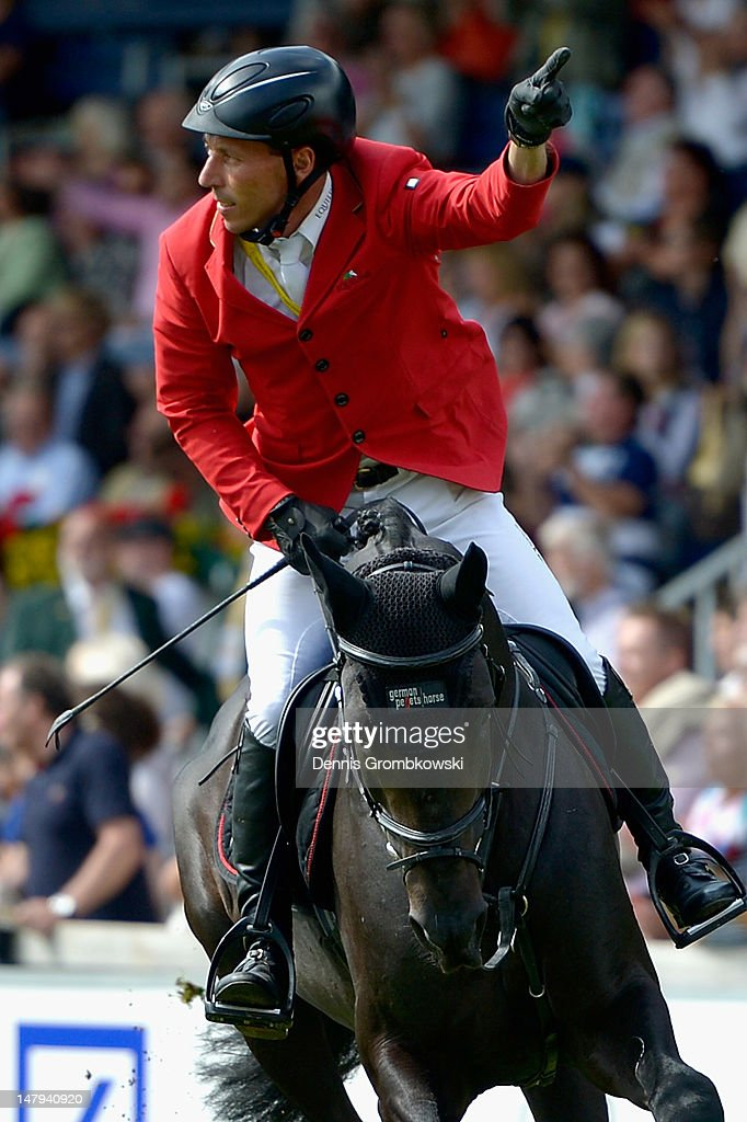 Hans-Dieter Dreher of Germany celebrates after finishing second with his horse Embassy II in the RWE Prize of North-Rhine-Westphalia jumping competition during day four of the 2012 CHIO Aachen tournament on July 6, 2012 in Aachen, Germany.