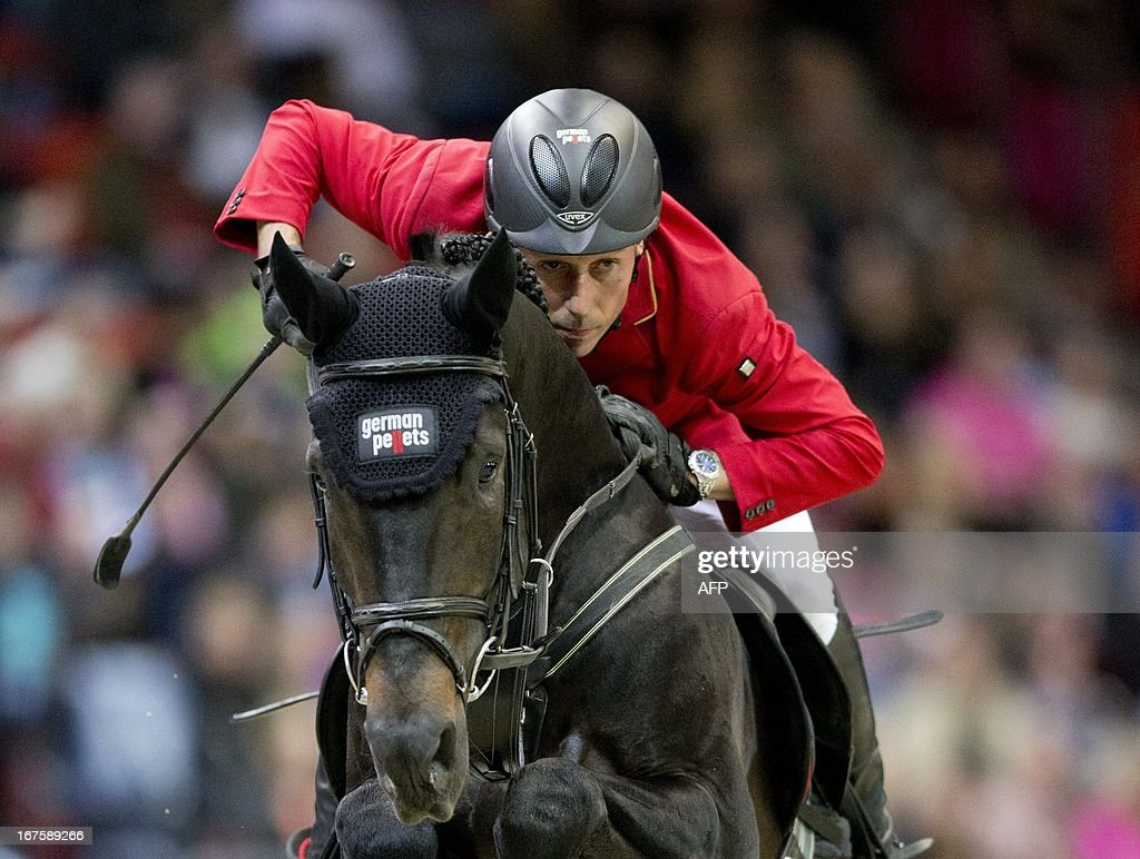 Hans-Dieter Dreher of Germany rides Embassy II during the Rolex FEI World Cup Jumping final on April 26, 2013 during the Gothenburg Horse Show in Scandinavium. AFP PHOTO