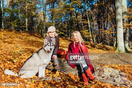 Hansel and Gretel, Boy and girl sitting in forest on a tree trunk